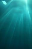 Superficie y luz del sol del agua Foto de archivo libre de regalías