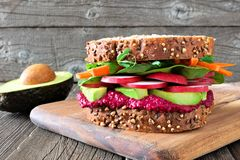 Superfood sandwich against a wooden background Royalty Free Stock Images
