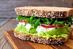 Superfood sandwich with, avocado, egg whites, radishes and pea shoots. Superfood sandwich with whole grain bread, avocado, egg whites, radishes and pea shoots on Stock Images