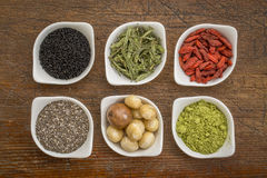 Superfood set in small bowls against wood royalty free stock photo