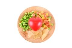 Superfood sur la forme en bois de coeur de plat d'isolement sur le blanc Images stock
