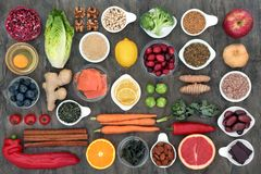 Superfood to Slow the Ageing Process. Concept including fish, fruit, vegetables, herbs, spices, supplement powders, green tea and dairy. High in antioxidants stock images