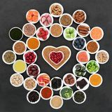 Superfood to Slow Ageing Process. Superfood to slow the ageing process including fruit, vegetables, herbs, spices, fruit, fish, supplement powders, seeds and royalty free stock images