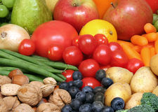 Superfoods. Background of some of the healthiest fruits, nuts and vegetables Stock Photo
