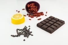 Superfoods; chocolate, goji berries and lemon Royalty Free Stock Photography