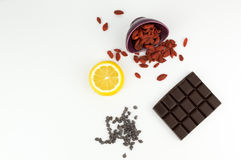 Superfoods; chocolate, goji berries and lemon Royalty Free Stock Image