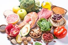 Superfoods en el fondo blanco Nutrición sana imagen de archivo libre de regalías