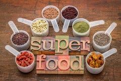 Superfoods en tipografía del sccop y de la prensa de copiar fotos de archivo