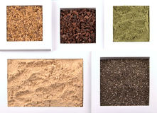 Food spices. Top view image of several superfoods, in order: linseeds / flax seeds, raw cocoa, wheatgrass, maca powder and chia seeds, with copy space royalty free stock photos