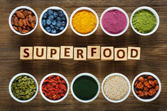 Superfoods on wooden table Royalty Free Stock Photos