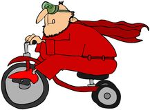 Superheld auf einem Dreirad Lizenzfreie Stockfotografie