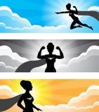 Superheld-Mädchen-Schattenbild-Fahne Stockfoto