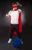 Superheld mit Reinigungsanlage Stockfoto