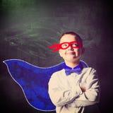 Superheldschuljunge Lizenzfreie Stockfotos