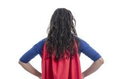 Superhero γυναικών με το κόκκινο ακρωτήριο στοκ εικόνα