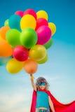 Superhero με τον τομέα μπαλονιών παιχνιδιών την άνοιξη Στοκ εικόνα με δικαίωμα ελεύθερης χρήσης