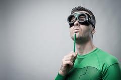 Superhero που σκέφτεται με το πράσινο μολύβι Στοκ Φωτογραφία