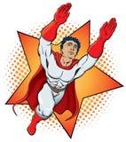 Superhero. A muscular superhero flies into view Stock Image