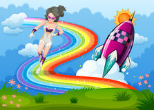 A superhero above the rainbow and a rocket Royalty Free Stock Images