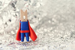 Superhero abstract concept. Clothespin super hero. Clothespin superhero in blue suit and red cape. shallow dof. soft background Stock Images