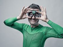 Superhero adjusting glasses Royalty Free Stock Photography