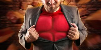 Superhero binnen Th-zakenman Stock Fotografie