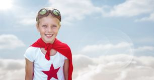 Superhero boy against sky with flare. Digital composite of Superhero boy against sky with flare Stock Images