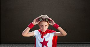 Superhero boy with blackboard background. Digital composite of Superhero boy with blackboard background Stock Images