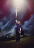 Superhero Boy with Lightning Sword in Sky Stock Photos