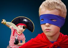 Superhero boy and pirate boy with blue background Royalty Free Stock Image