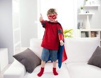 Superhero boy thumb up Stock Image