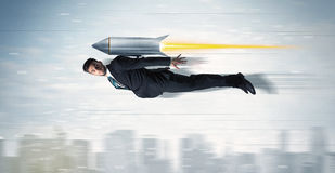 Superhero business man flying with jet pack rocket above the cit. Y concept stock photos