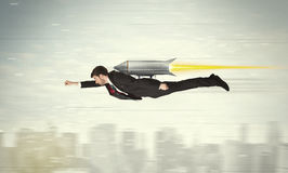Superhero business man flying with jet pack rocket above the cit Royalty Free Stock Images