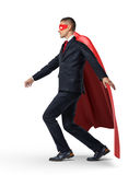 A superhero in a business suit and a red cape keeping his balance on an invisible rope. Success and failure. Risk management. Insecurity Stock Photo