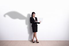 Superhero Business Woman with computer royalty free stock photo