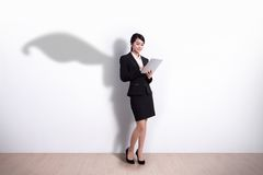 Superhero Business Woman with tablet royalty free stock photo