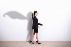 Superhero business woman walking royalty free stock image
