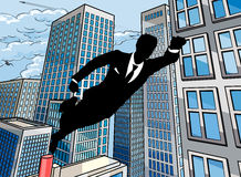 Superhero Businessman. A superhero business man flying through the air over a city scene Stock Photography