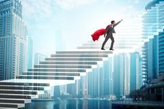 The superhero businessman climbing career ladder. Superhero businessman climbing career ladder stock photos