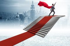 The superhero businessman climbing red carpet stairs. Superhero businessman climbing red carpet stairs Royalty Free Stock Photo