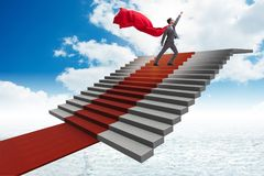 The superhero businessman climbing red carpet stairs. Superhero businessman climbing red carpet stairs Royalty Free Stock Images