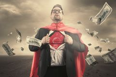 Superhero businessman concept. With dollar bills flying Stock Image