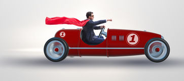 The superhero businessman driving vintage roadster stock image
