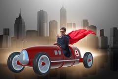 The superhero businessman driving vintage roadster Royalty Free Stock Photo