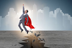 The superhero businessman escaping from difficult situation. Superhero businessman escaping from difficult situation Stock Photography