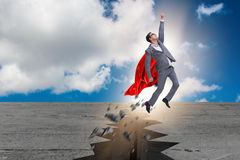 The superhero businessman escaping from difficult situation. Superhero businessman escaping from difficult situation Royalty Free Stock Image