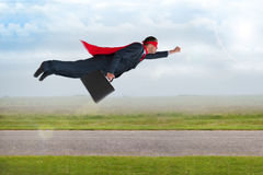 Superhero businessman flying Stock Images