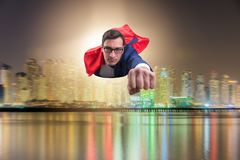 The superhero businessman flying over the city royalty free stock photos