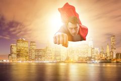 The superhero businessman flying over the city stock images