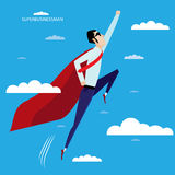 Superhero businessman flying in sky Royalty Free Stock Photo